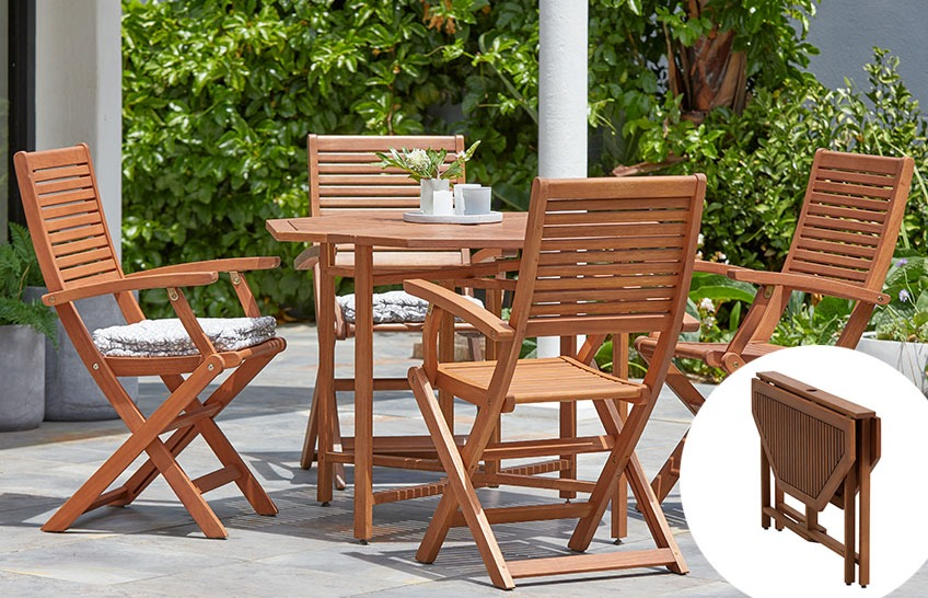 Garden set with wooden garden table and 4 wooden garden chairs on a patio