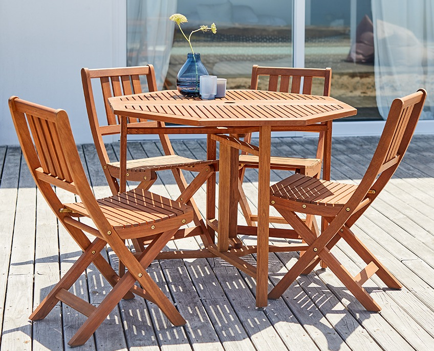 Wooden garden set with table and 4 chairs on a wooden patio