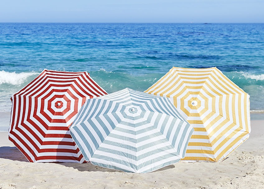 Three large parasols on a beach