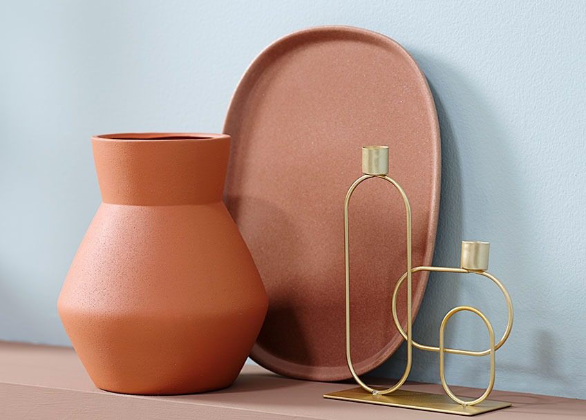 Terracotta vase, tray, and candlestick