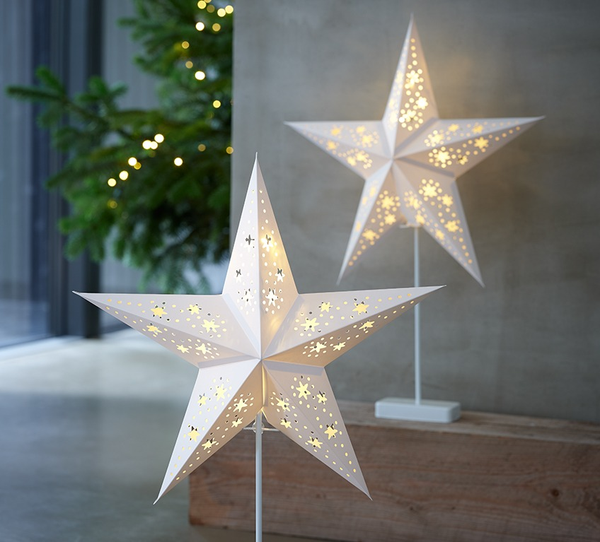 Two battery lamps shaped as white Christmas stars