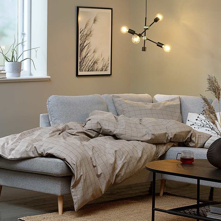 "Living room ""hygge"" with big corner sofa, duvet and lighting"